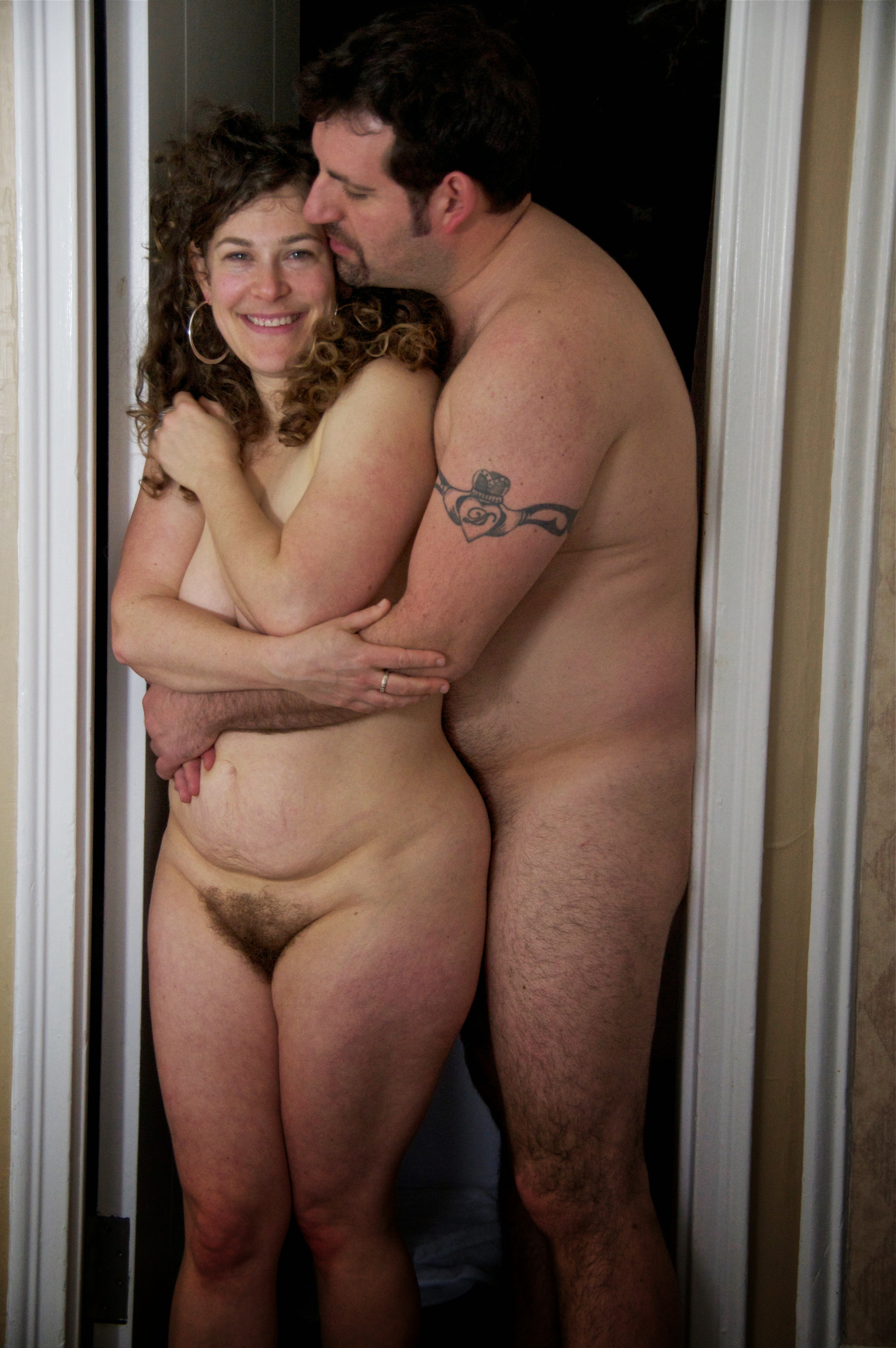 Naked couple in doorway