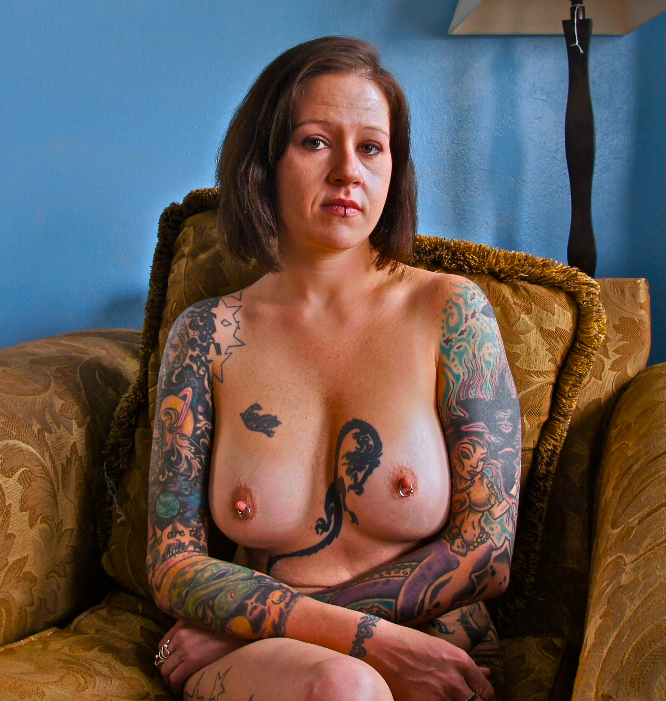 Tattooed woman and piercings