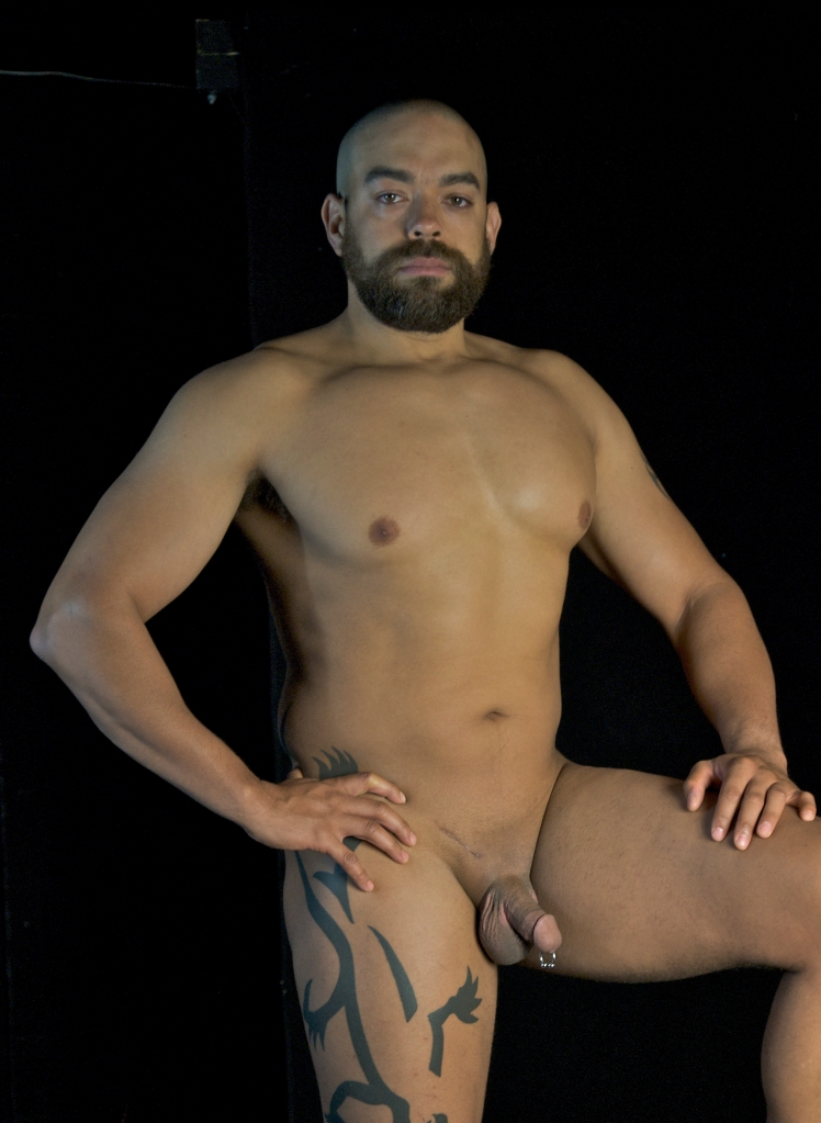 Nude mixed-race male body builder with piercing