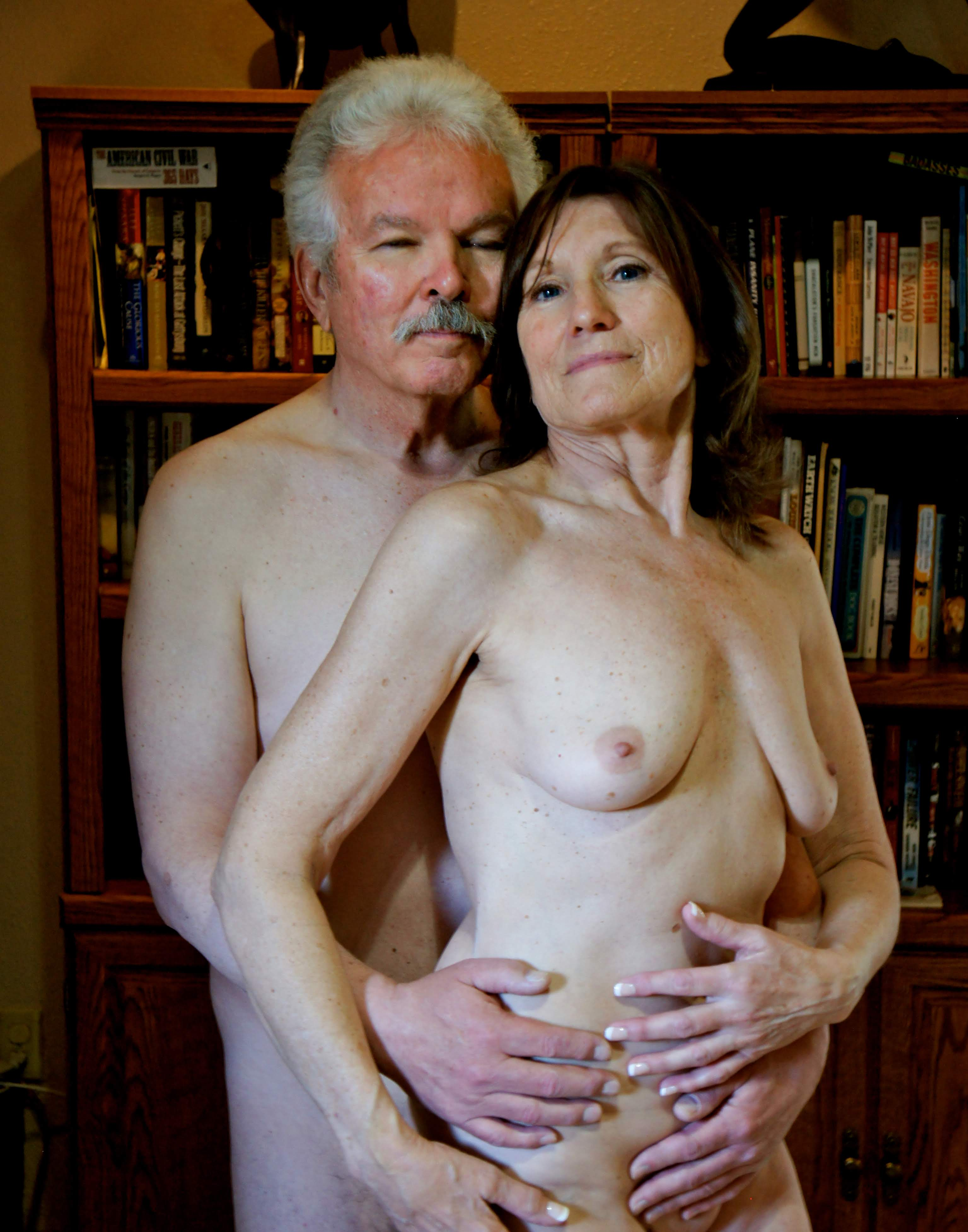 Nude older couple embrace