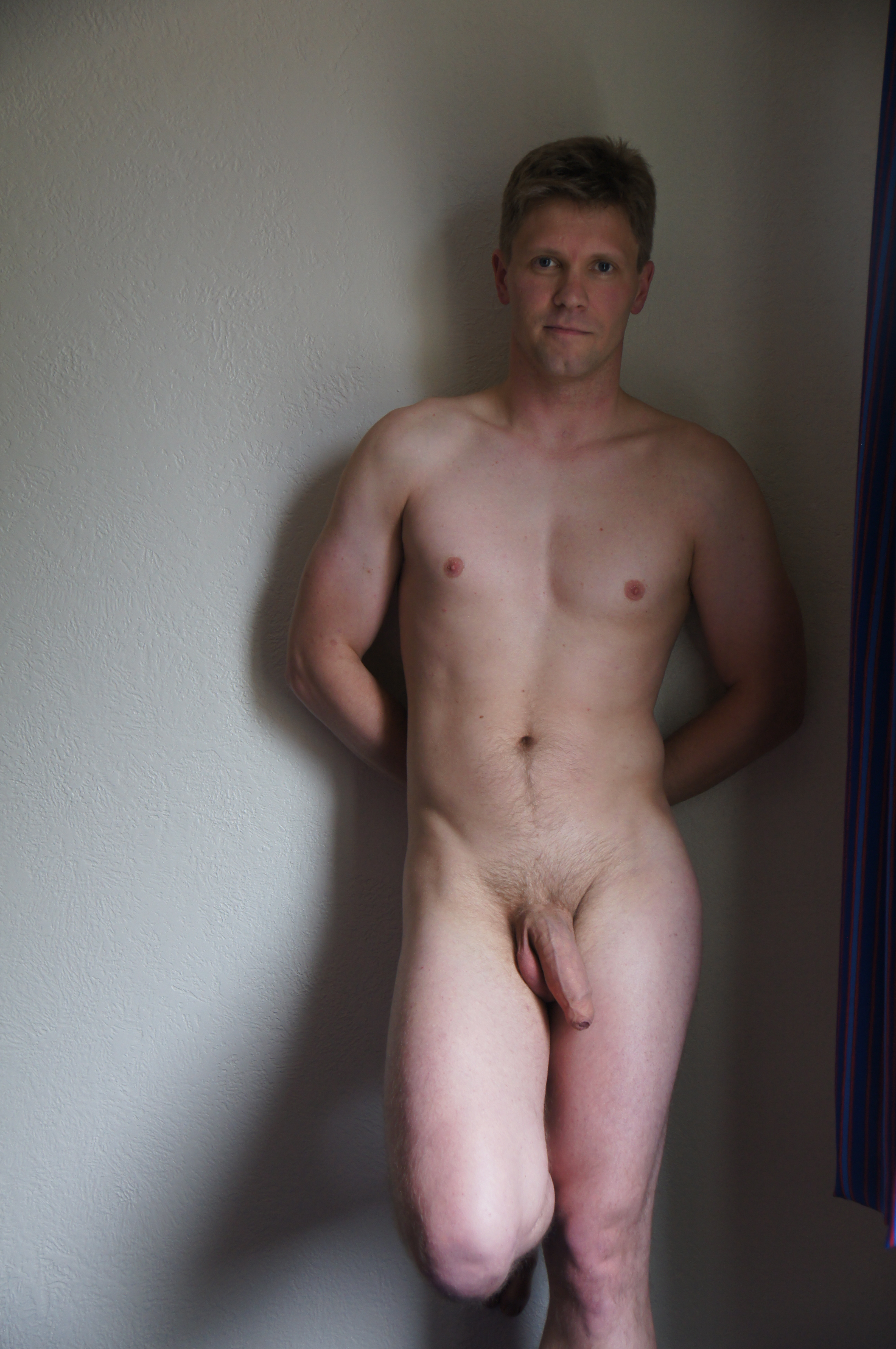Naked man with uncut penis