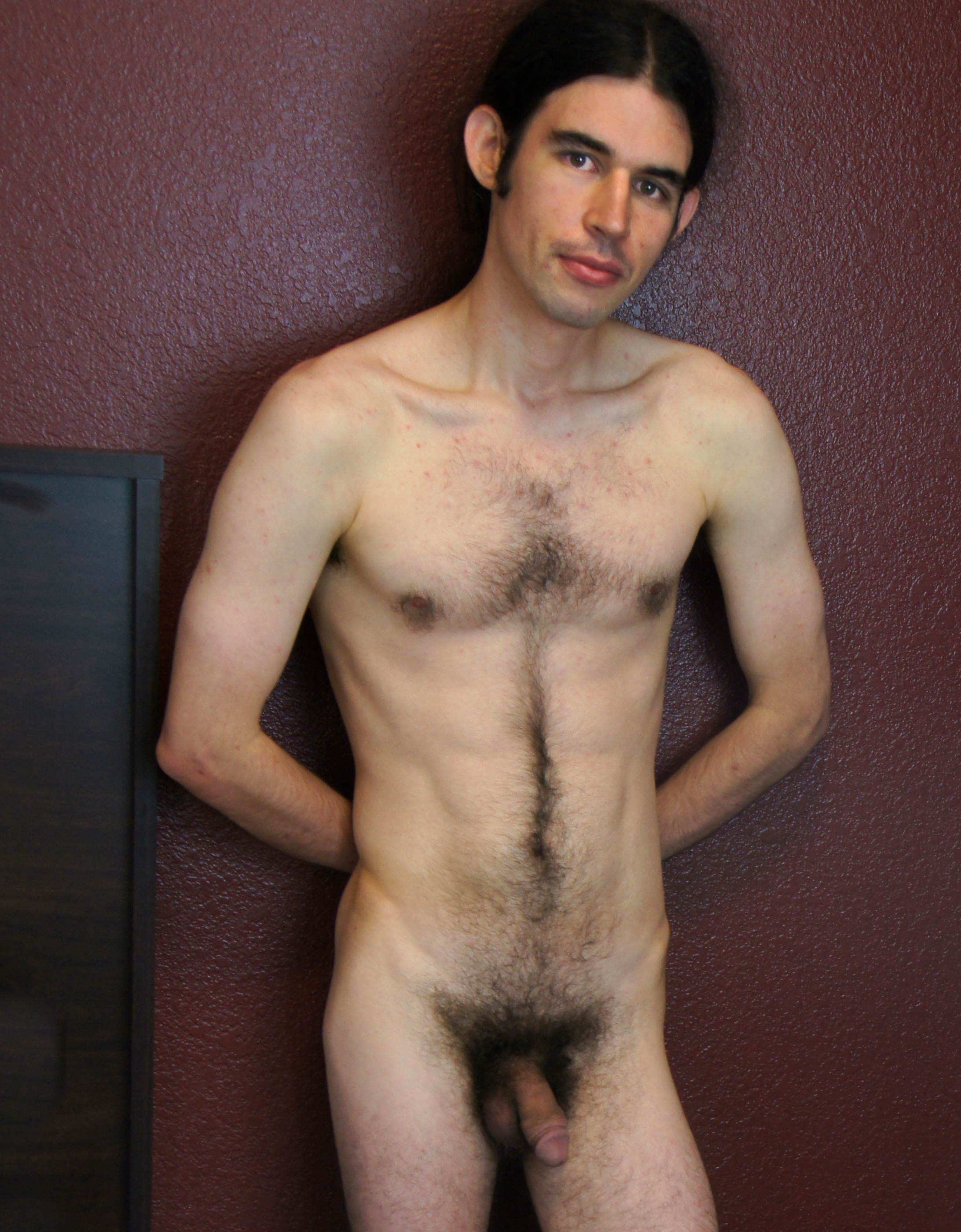 Naked hairy caucasian male standing