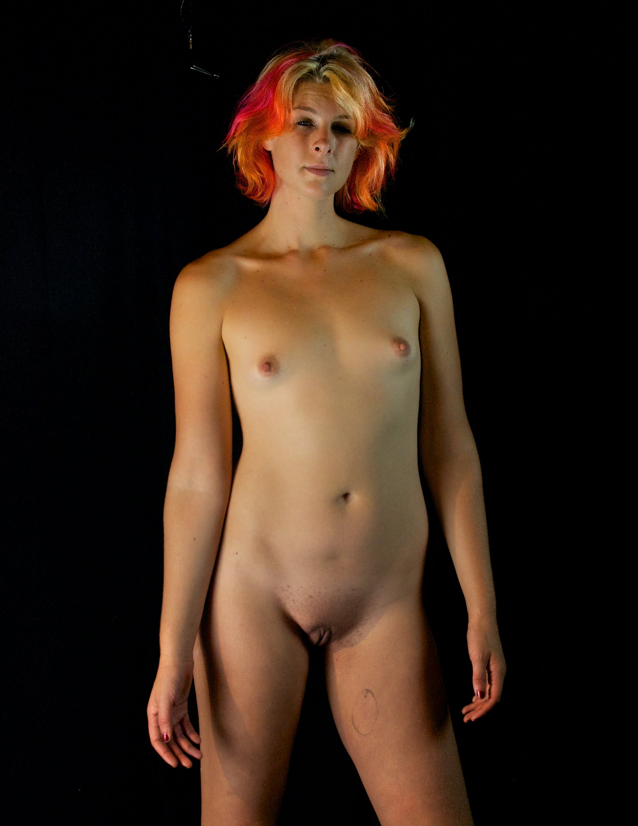 Tall nude woman with rainbow hair