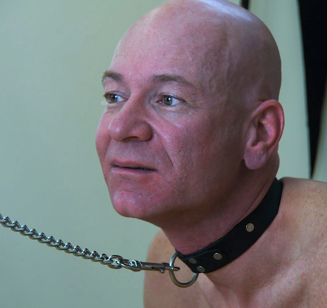 Bald man collared and leashed, BDSN