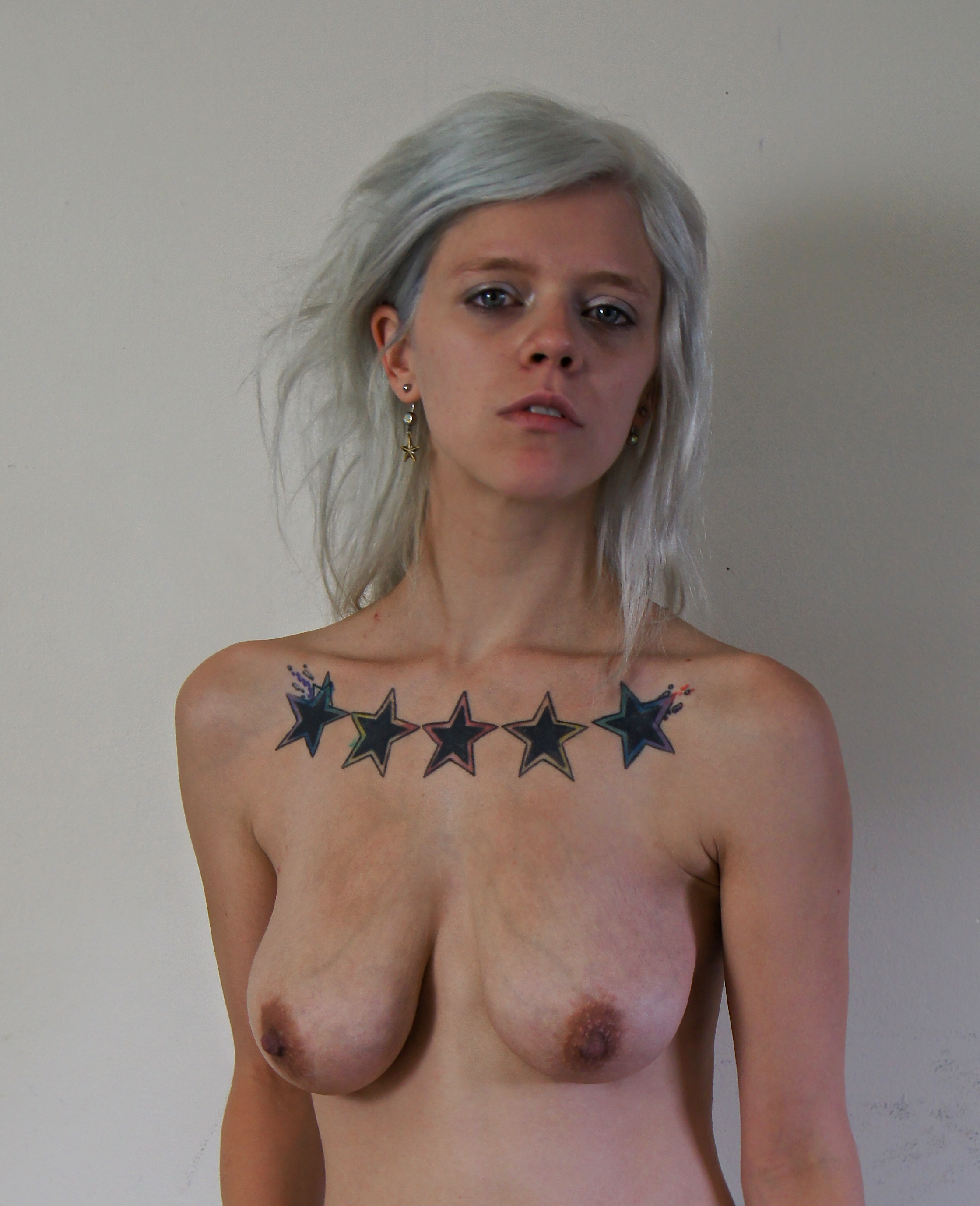 Woman with platinum hair and tattoos