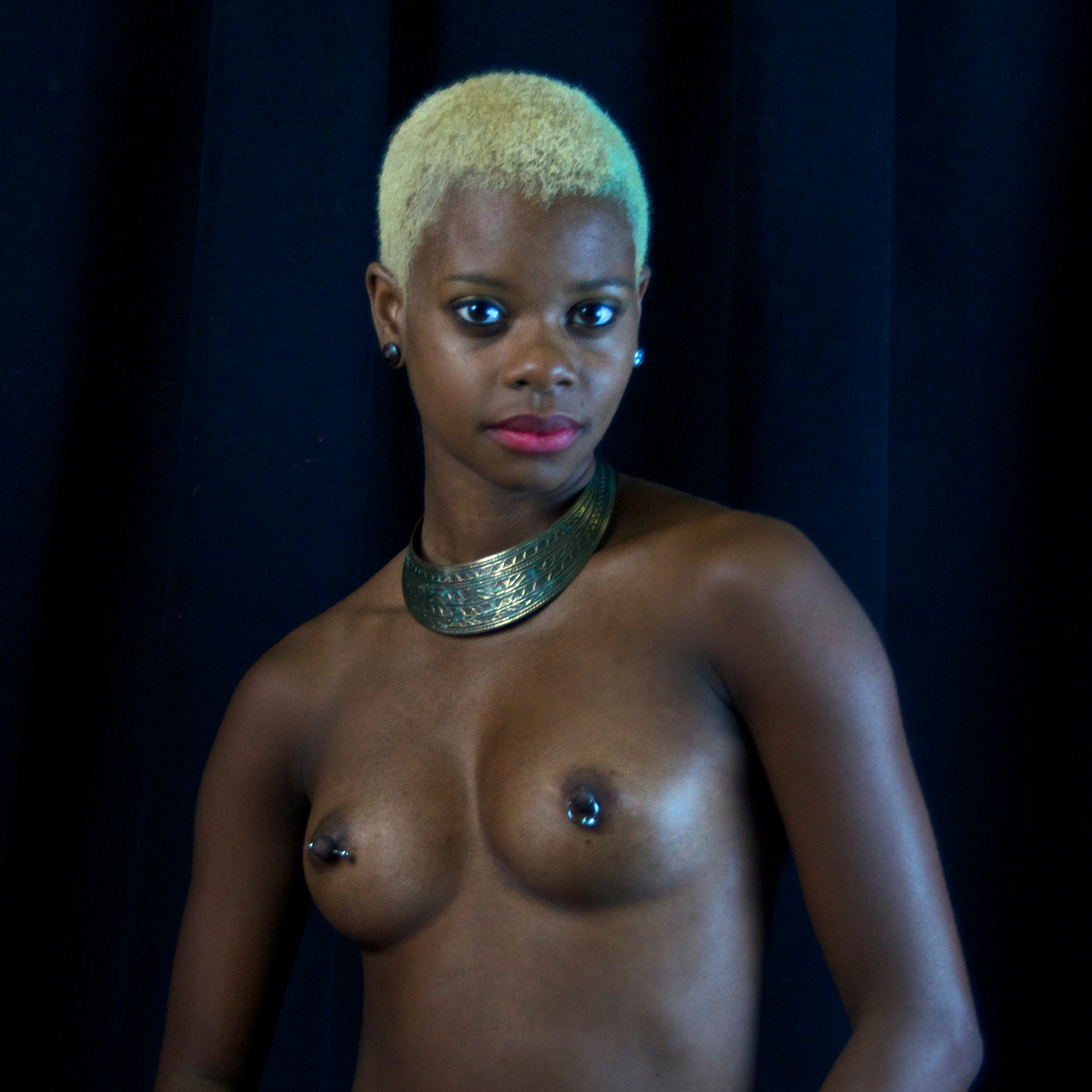 African-American woman with pierced nipples