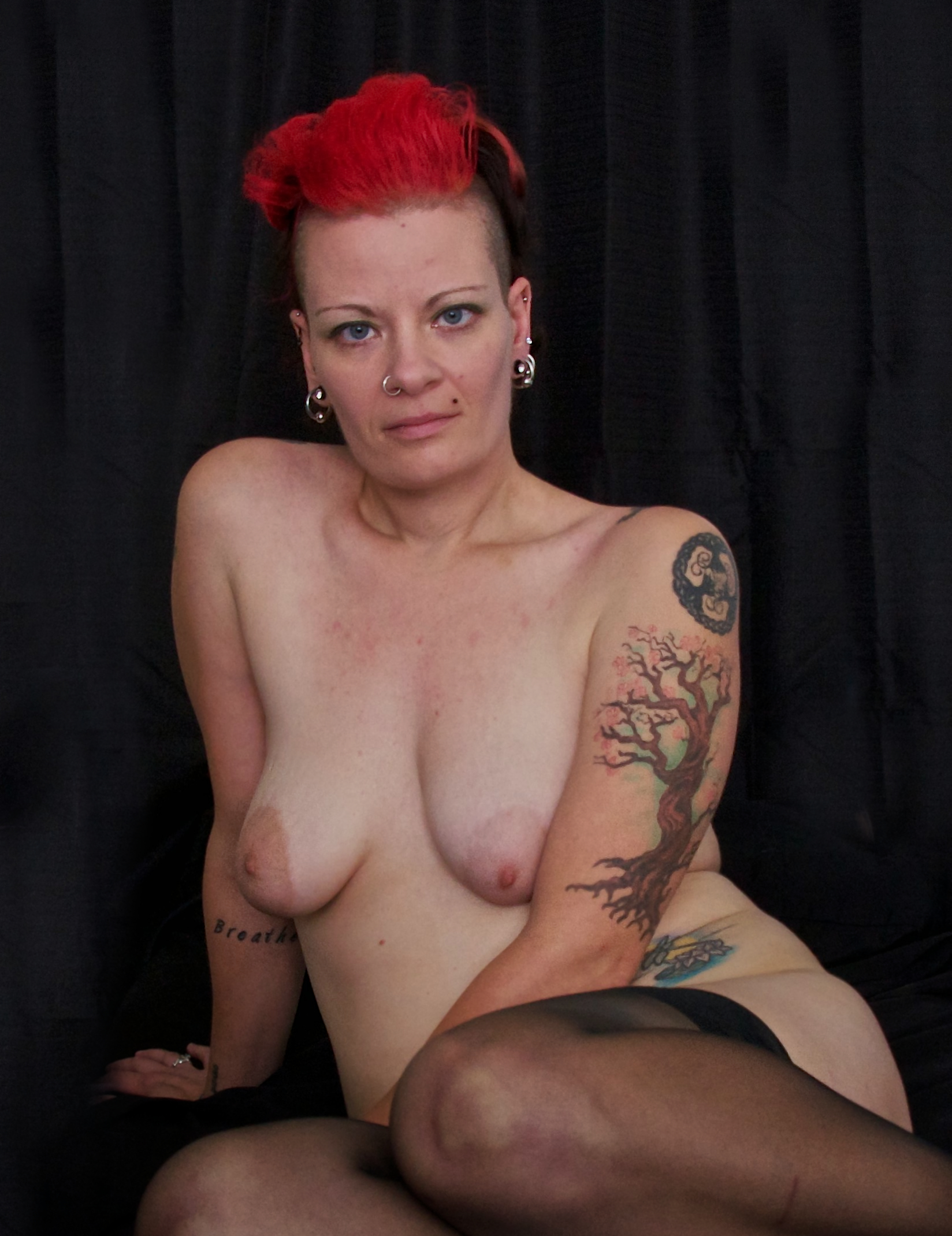 Bisexual woman with bright red hair