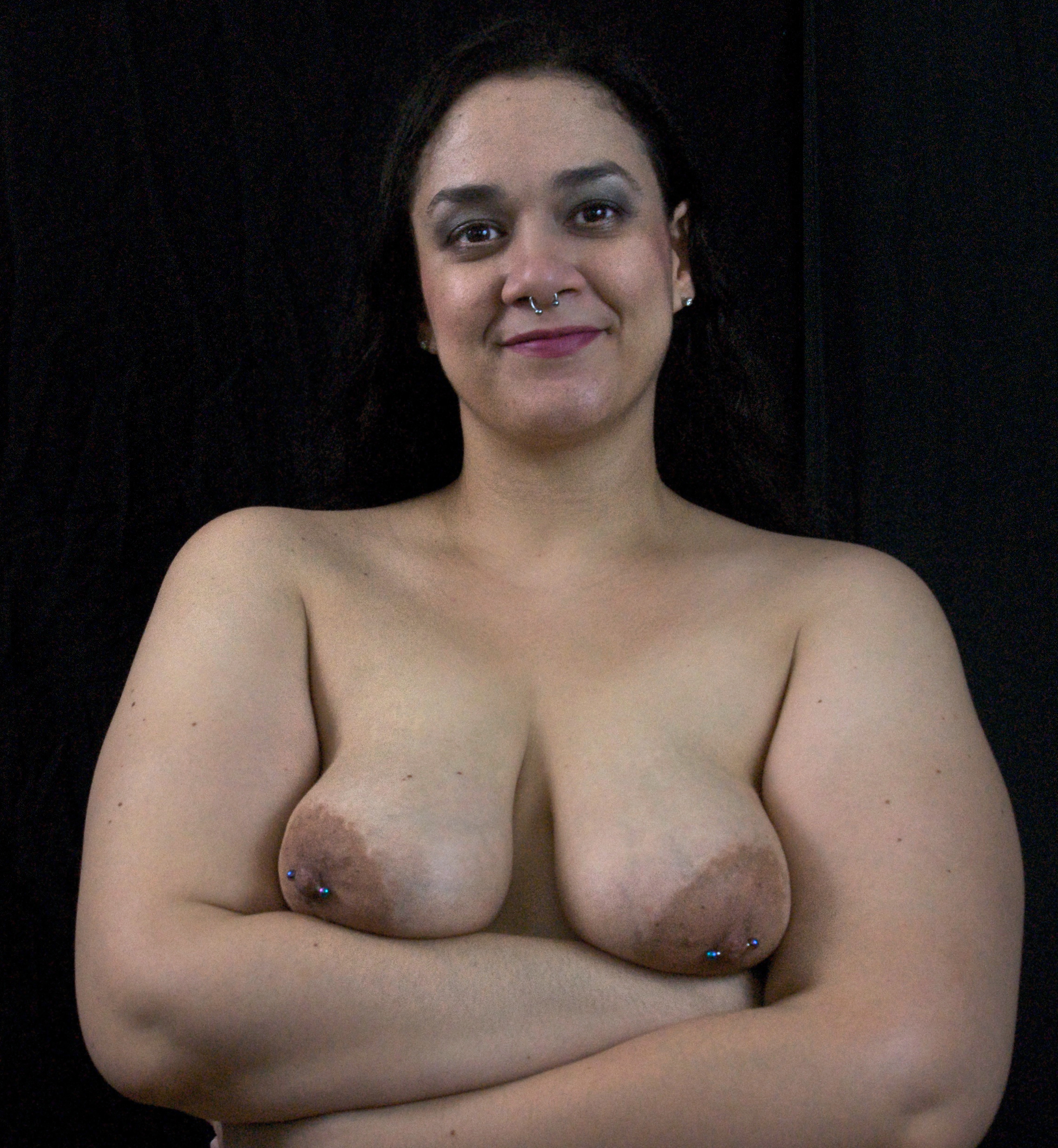 Smiling Samoan woman with pierced nipples