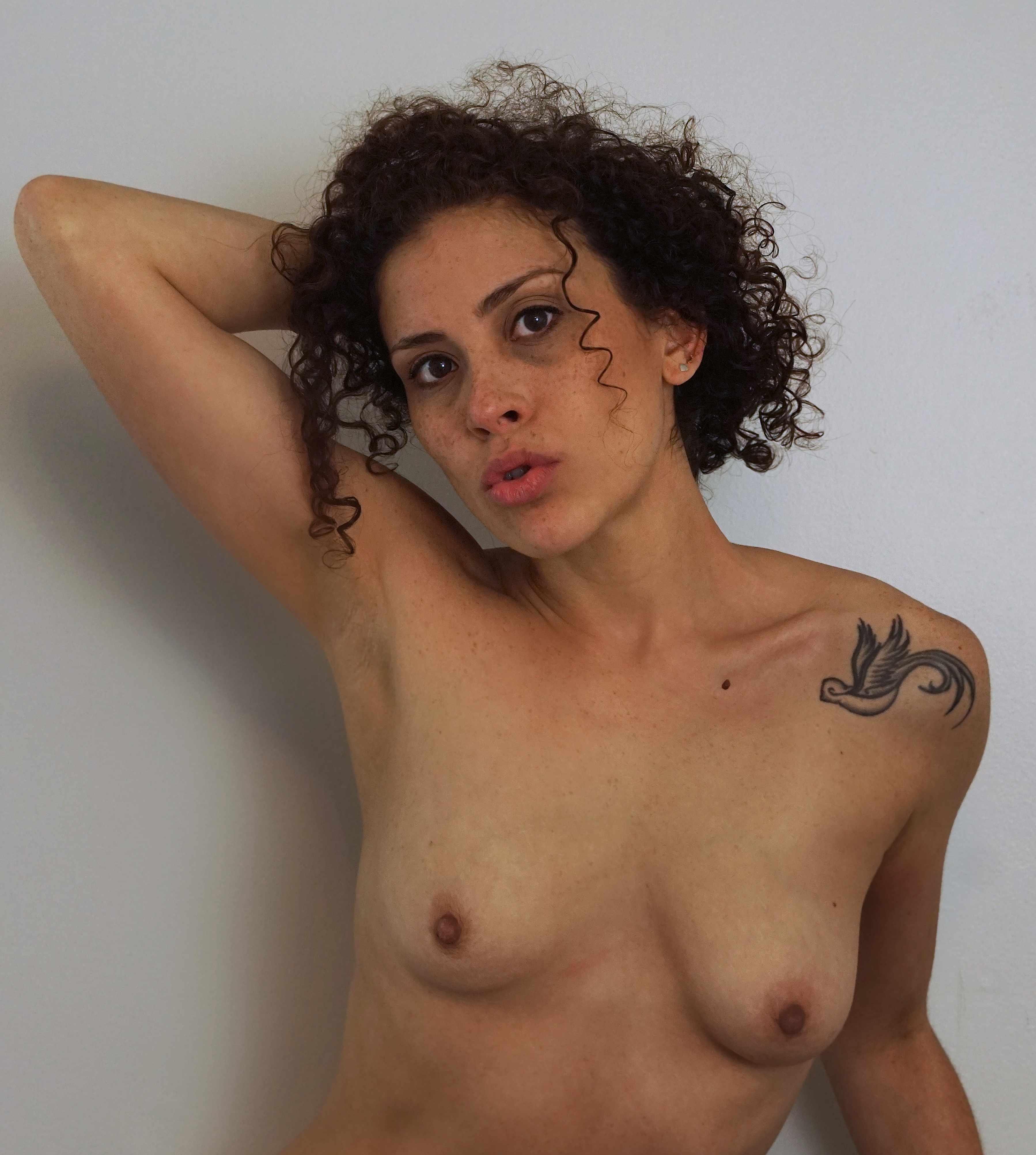 Bare-breasted Puerto Rican woman