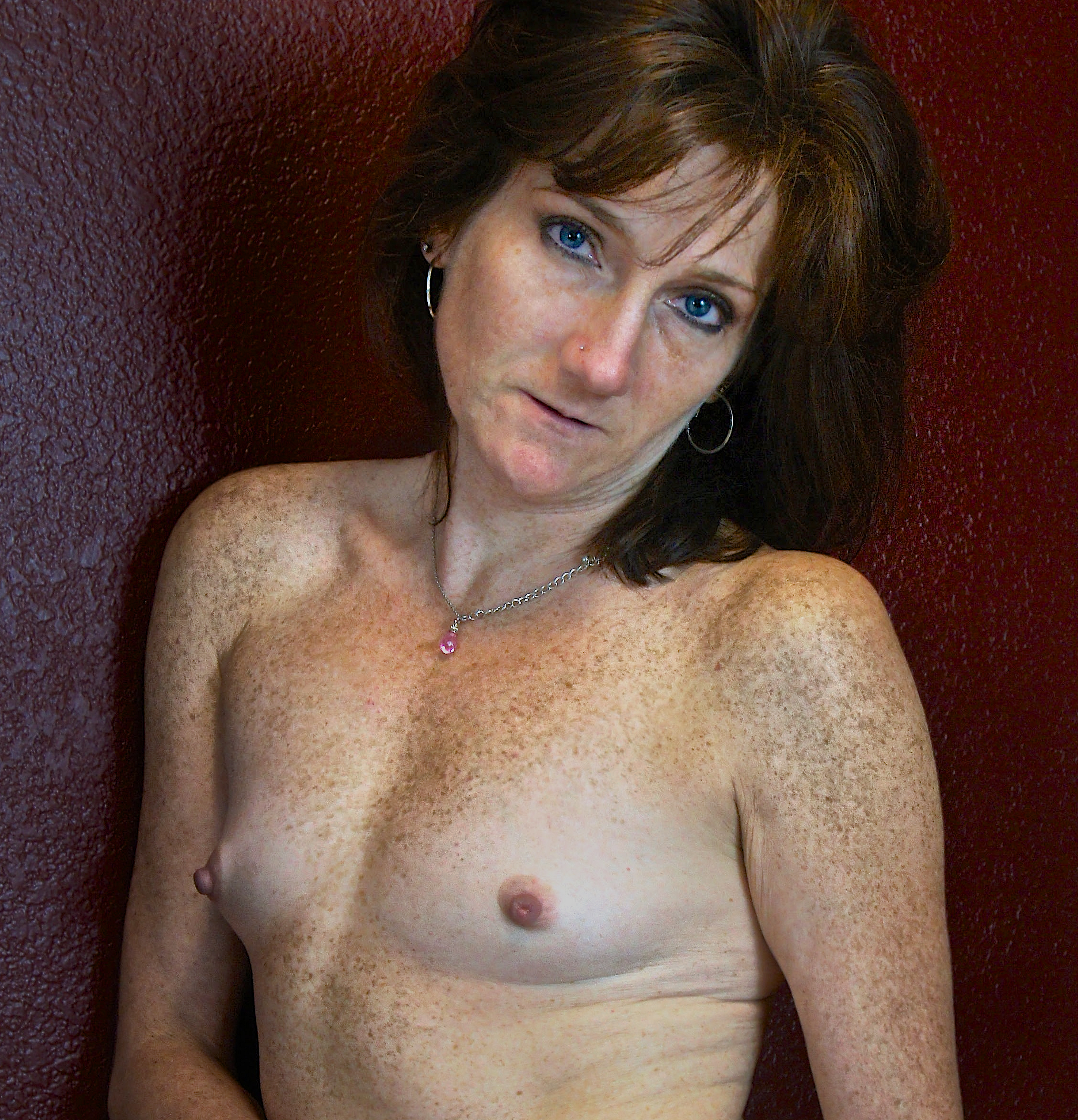 Woman with freckles and blue-eyes